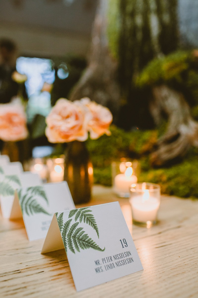 place cards with ferns - http://ruffledblog.com/modern-country-meets-secret-garden-wedding