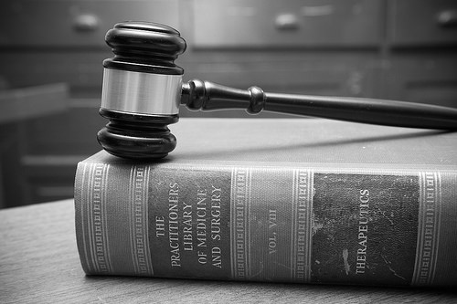 Black and White Gavel in Courtroom - Law Books