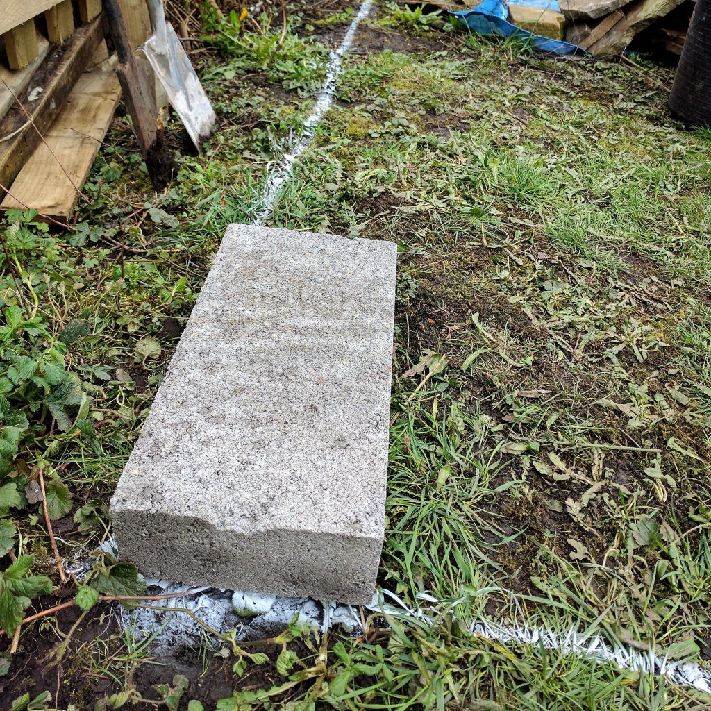 A block laid on the floor frame perimeter.