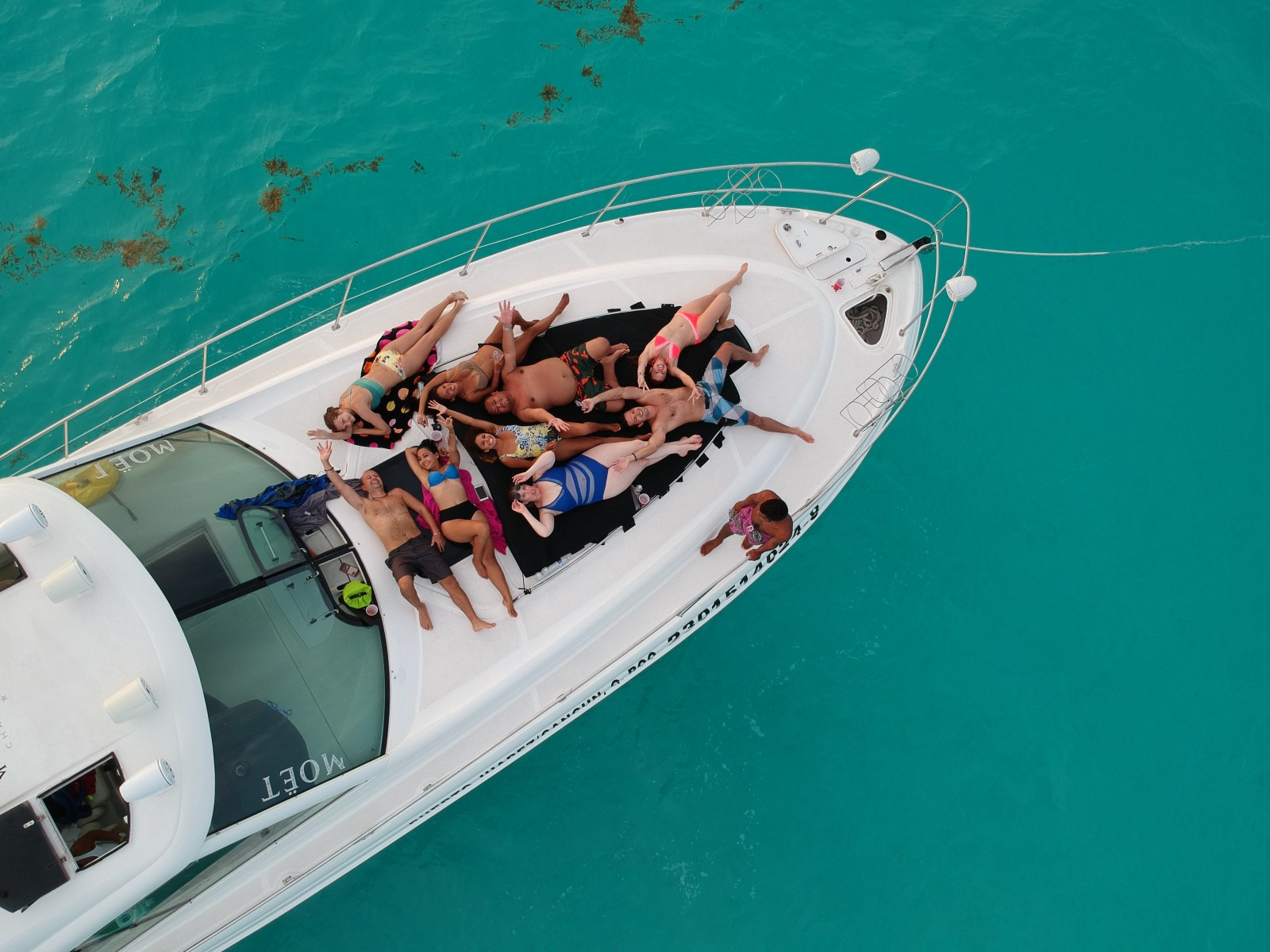 Aerial shot of yacht with friends