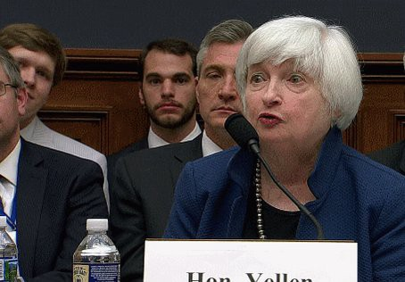 Someone held up a 'buy bitcoin' sign during Yellen's testimony to Congress