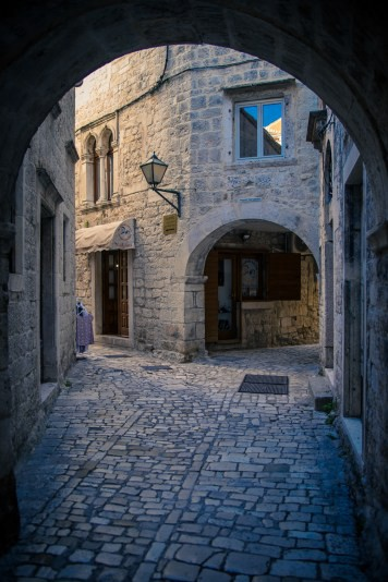 Arches and narrow alleyways in the medieval city of Trogir, Croatia