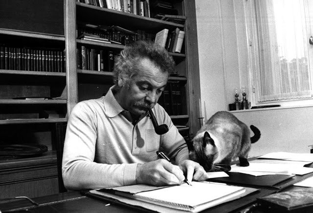 Brassens writing with a cat