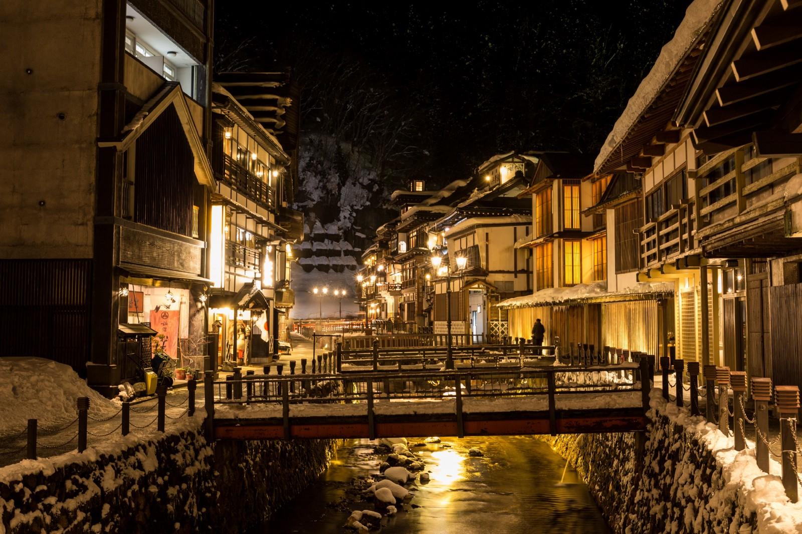 """321551d52c8 Ginzan (means """"Silver Mountain"""" in Japanese) Onsen is an Onsen town located  on the mountain in Yamagata Prefecture. The scenery of the town lined with  old ..."""