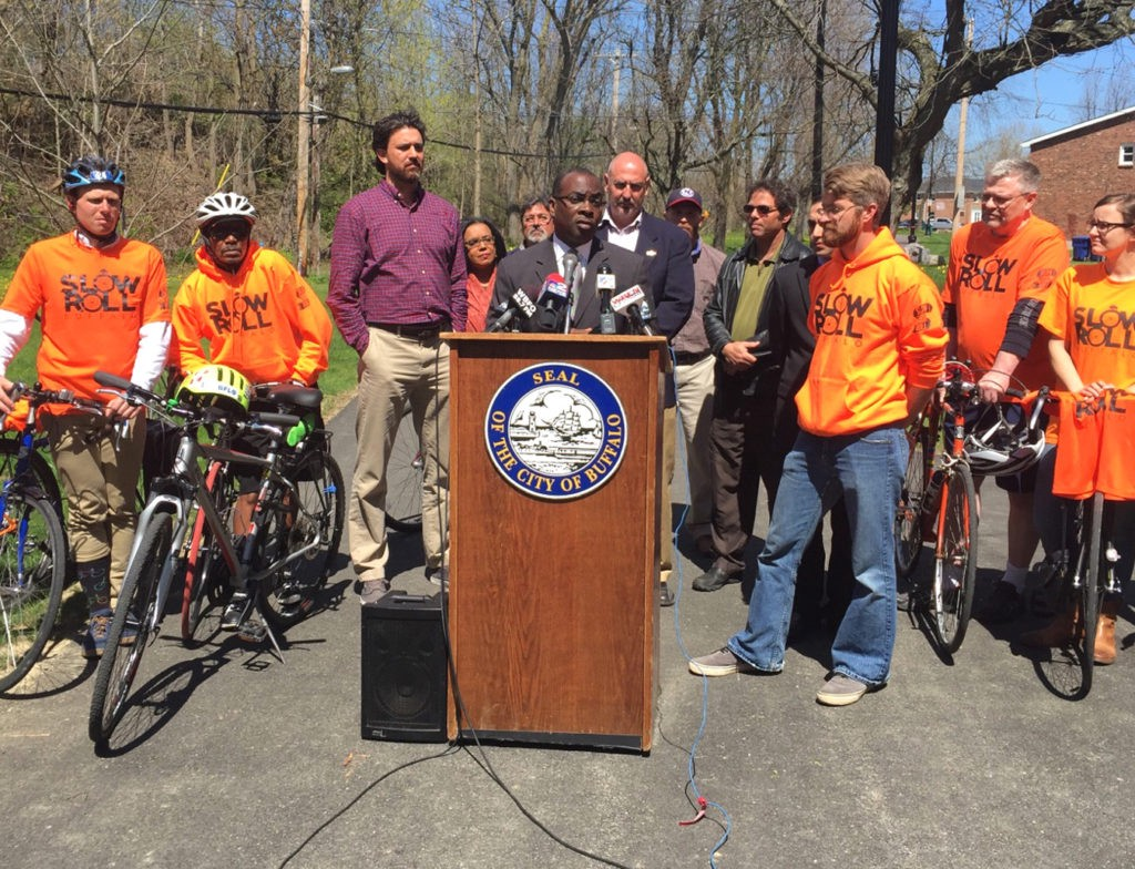 Alta Principal Jeff Olson (4th from right) spoke at Mayor Brown's May 6 press conference announcing the completion of the Buffalo Bike Plan.