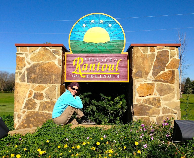 MsBoyink posing by the sign of her birth city.