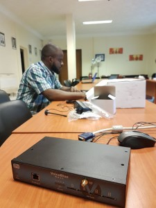 A Nigeria IT Officer working to install a GSM gateway for IVR usage in Maiduguri WFP/Lucia Casarin