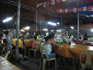 Eating at the hall opposite the National Bakery, Laoag.