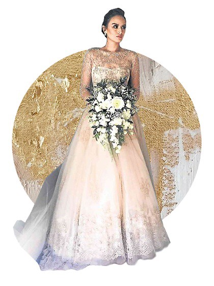 Georgina Wilson Went For A Monique Lhuillier Embellished Gown The Beige Wedding Dress Features Sheer Long Sleeves Decorated In Heavy Beadwork Up Until