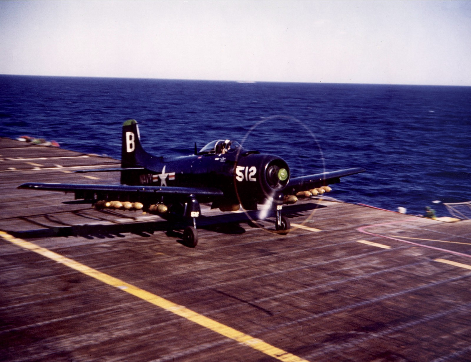 An AD Skyraider takes off from the USS Princeton for a strike in Korea. Navy photo