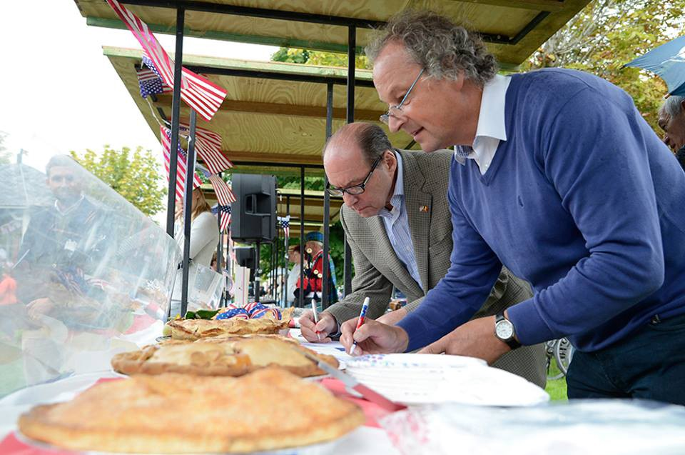 U.S. Ambassador Ronald Gidwitz and Mayor Marc Lewyllie, participate in the first-ever American Day celebration in Heuvelland, Belgium, on Sunday, August 26, 2018.