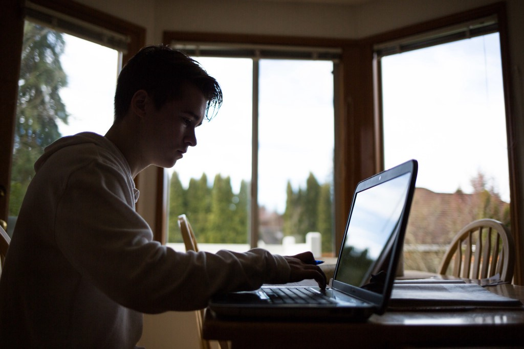 Hansen uses his computer for homework at his home in Mukilteo. To help deal with his disorder, Hansen adheres to some recommendations to help reduce fatigue like avoiding alcohol and nicotine.