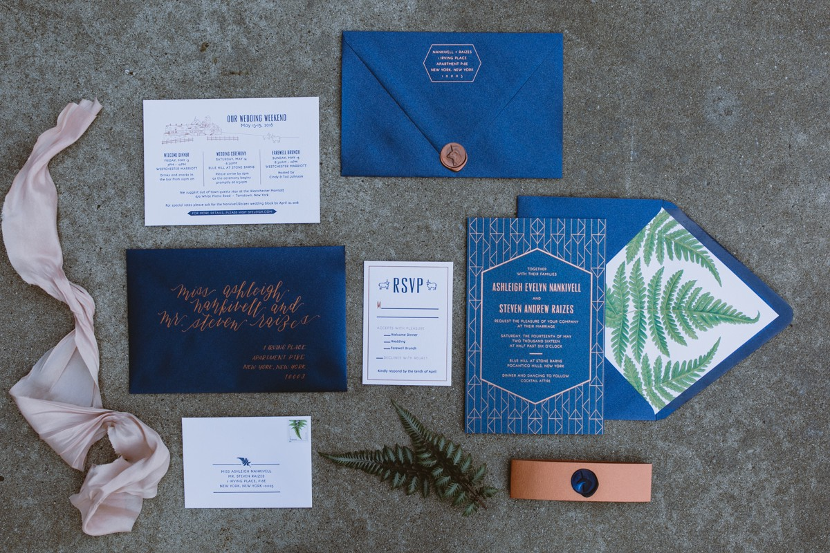 blue wedding stationery - http://ruffledblog.com/modern-country-meets-secret-garden-wedding