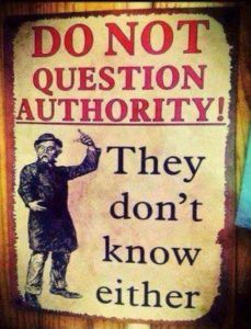 """A sign that says """"Do not question authority! They don't know either."""""""