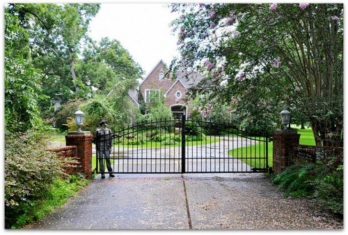 A normal looking gate for a mansion until you look closely