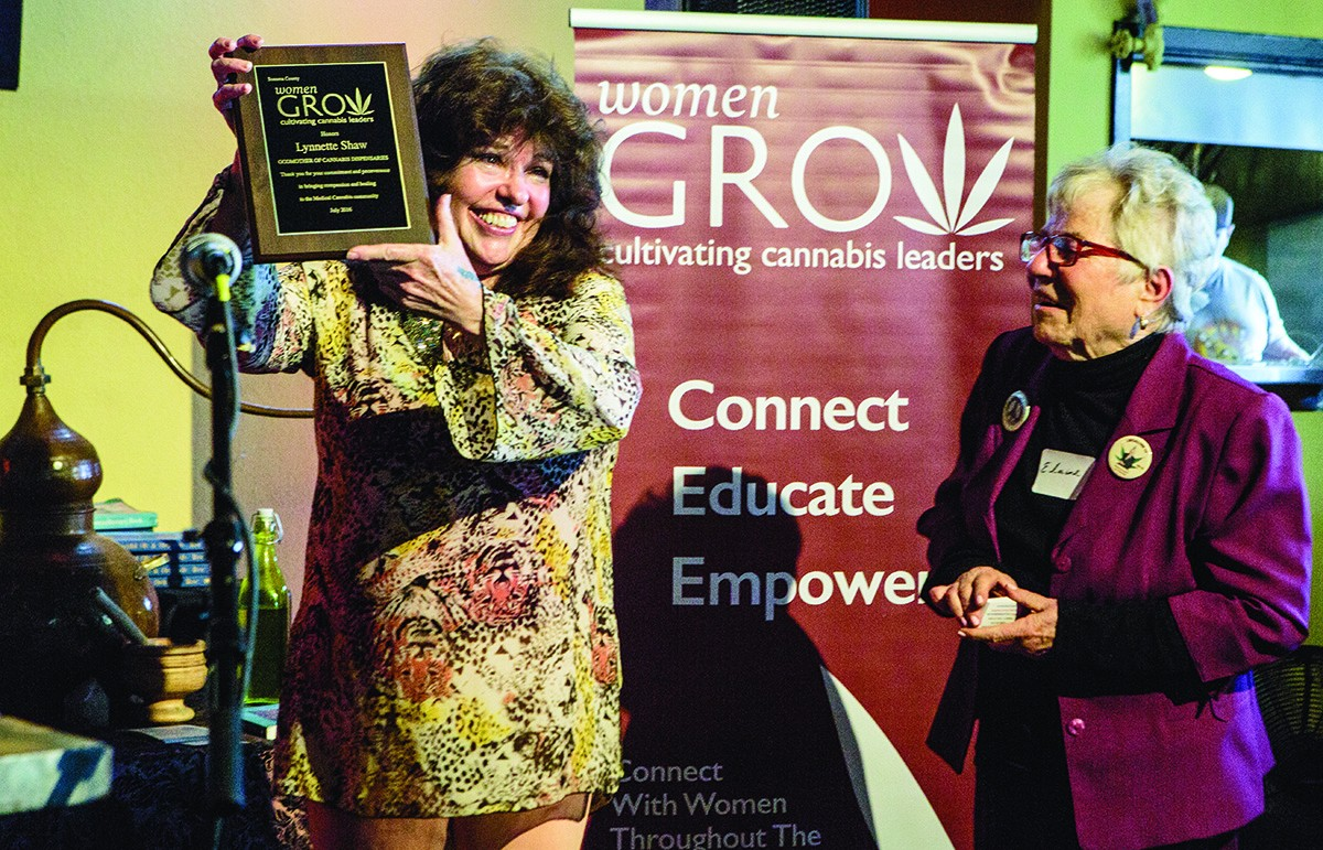 "Lynnette Shaw recieves a WomenGROW honors award as the Godmother of Cannabis, stands next to Elaine B. Holtz Producer/Host ""Women's Spaces"""