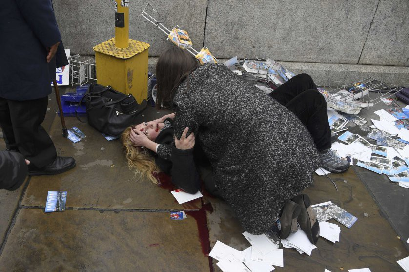 A woman lies injured after a shotting incident on Westminster Bridge in London, March 22, 2017. REUTERS/Toby Melville
