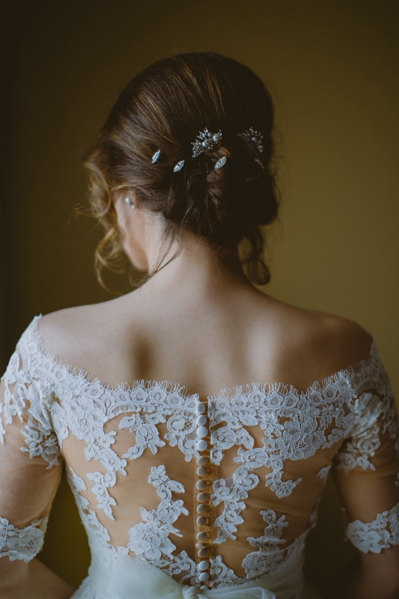 wedding dress detail - http://ruffledblog.com/modern-country-meets-secret-garden-wedding