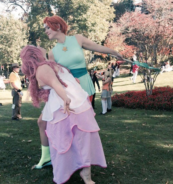 The author cosplaying as Rose Quartz with her girlfriend as Pearl.