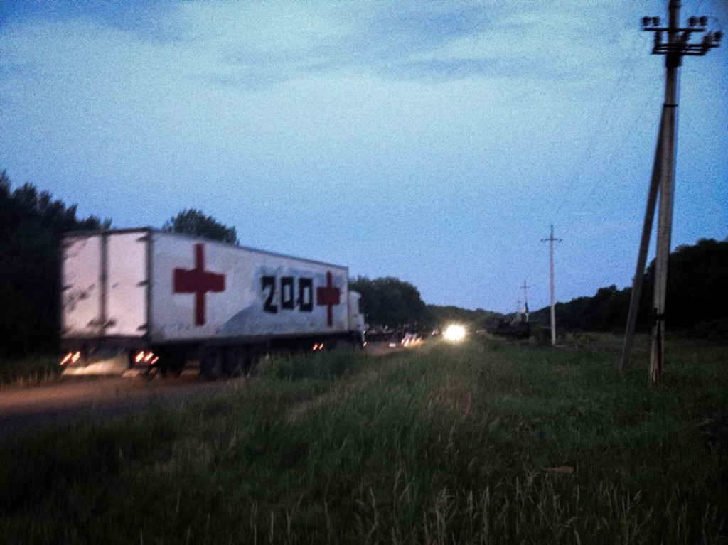 A truck full of the bodies of Russian fighters travels from Donetsk back to Russia (Noah Sneider)