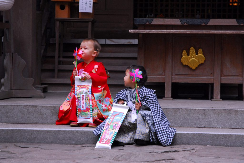 Shichi-Go-San, girl and boy with chitose-ame and a small toy