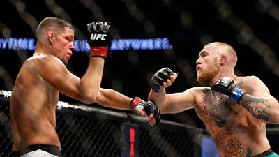 Conor Mcgregor attempts to land a trademark left on Nate Diaz UFC 202.