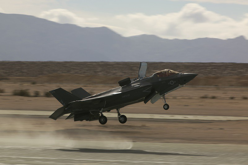 An F-35B Lightning II Joint Strike Fighter, Marine Fighter Attack Squadron 121, 3rd Marine Aircraft Wing, performs a conventional take-off at the Strategic Expeditionary Landing Field during Exercise Steel Knight 2016 aboard the Combat Center, Dec. 11, 2015. This year's iteration of Exercise Steel Knight works to advance 1st Marine Division's warfighting capabilities, to include interoperability between the ground and air forces and integration of the F-35B. (Official Marine Corps photo by Lance Cpl. Levi Schultz/Released)