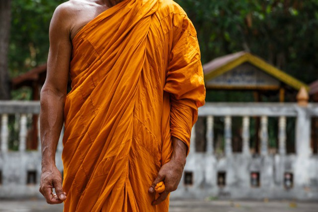 5d7e0585cf Why monks wear different color robes around the world.