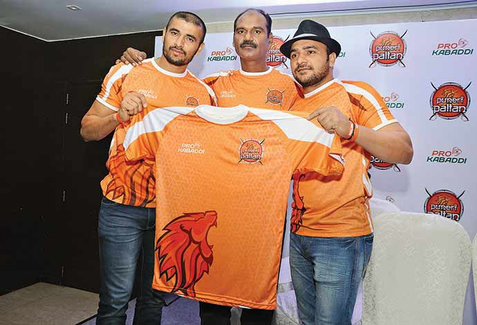 Puneri Paltan players in action in season 3. (Above) Assistant coach K Bhaskaran (c) along with Manjeet Chillar (R) and Ajay Thakur unveiling the team jersy