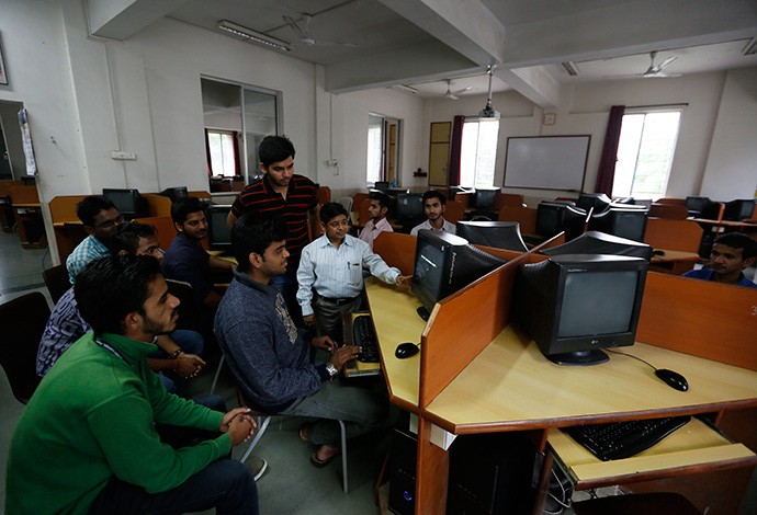 Professor Dhiraj Nage engrossed in guiding his students at Fergusson College