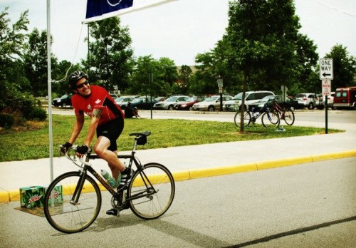 photo me crossing the finish line after the tour de cure 100 mile bike ride