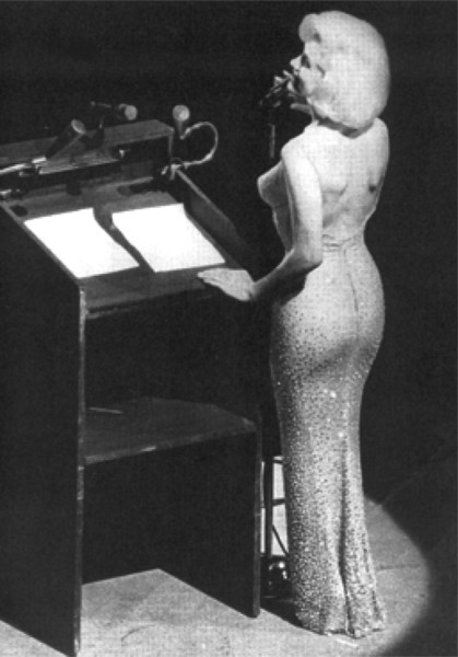 "Marilyn Monroe singing ""Happy Birthday"" to President John F. Kennedy at Madison Square Garden May 19, 1962."