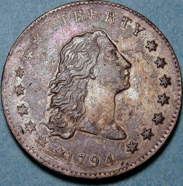 """Miss Liberty"" with long, flowing hair on the front of the coin ""flowing hair dollar"""