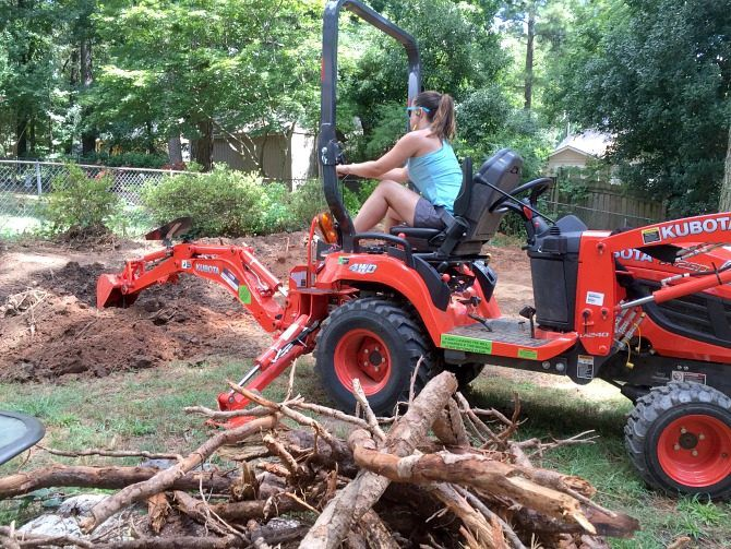 digging-up-tree-roots-with-backhoe