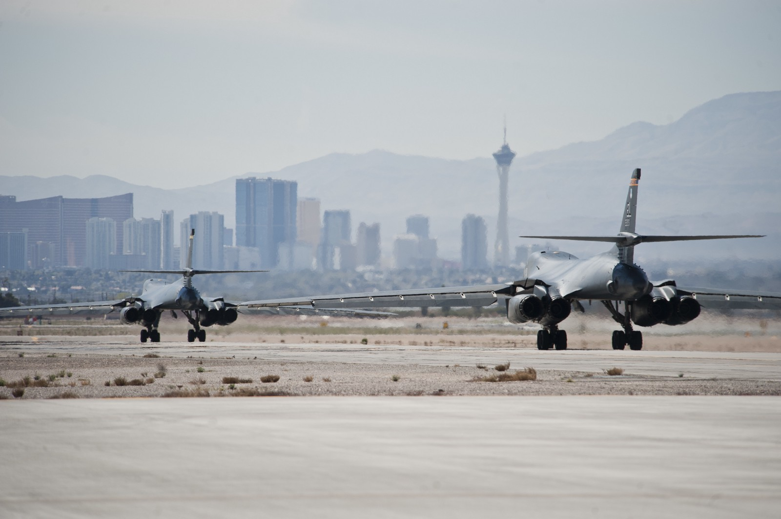 Two B-1B Lancers assigned to the 37th Bomb Squadron, Ellsworth Air Force Base, S.D., taxi during Red Flag 15-2 at Nellis AFB, Nev., March 10, 2015. Red Flag provides a series of intense air-to-air scenarios for aircrew and ground personnel to increase their combat readiness and effectiveness for future real-world operations. (U.S. Air Force photo by Staff Sgt. Siuta B. Ika)