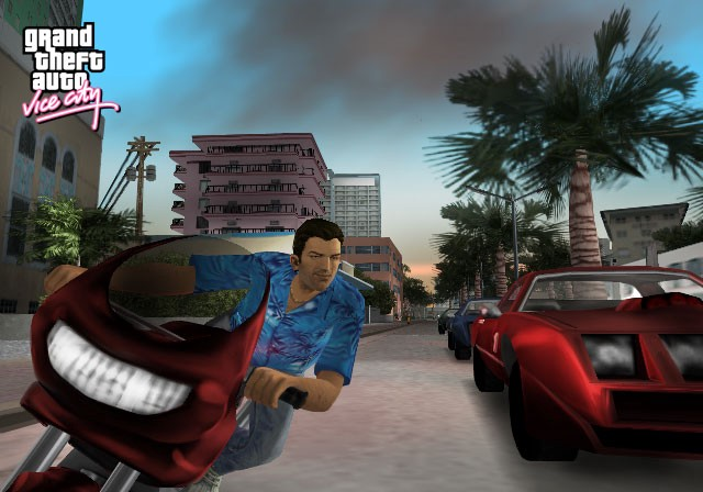 A screenshot from Grand Theft Auto: Vice City. The main character, Tommy Vercetti whizzes by a red convertible on a red motorcycle. The streets are lined with palm trees and high rises.