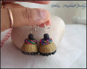 Polymer clay antique gold jhumkas size (medium) with multi coloured spiral caps INR 750