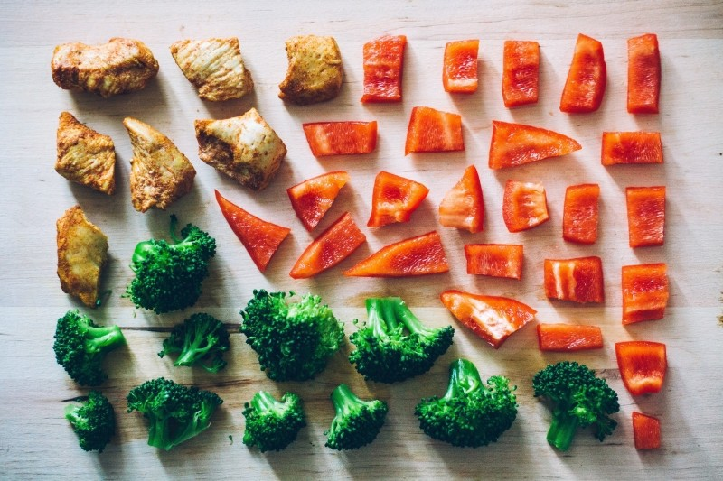 slices-of-meat-red-pepper-and-broccoli-on-table