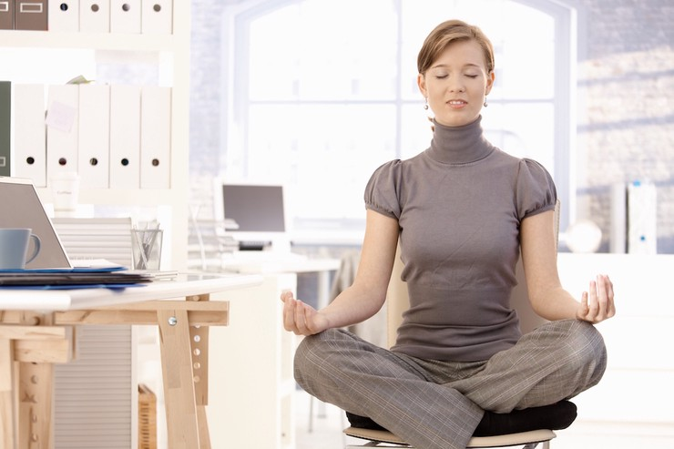 Lady doing yoga in office