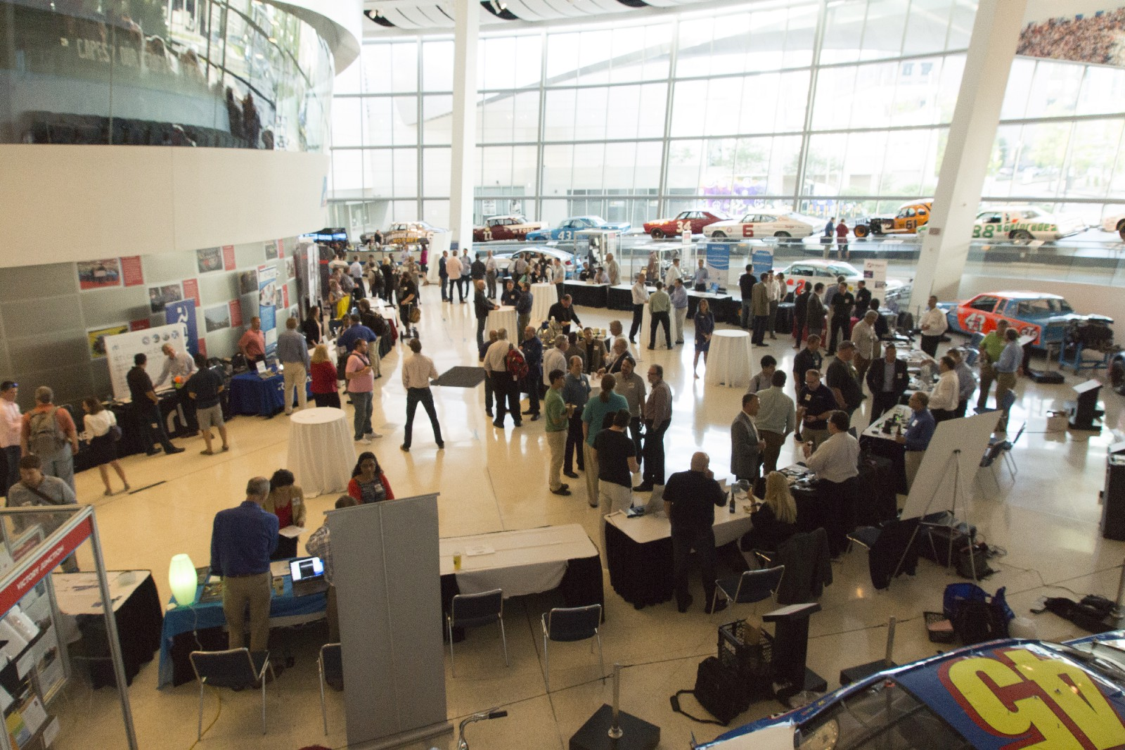 RIoT evening session with vendors spread out in the main hall of the NASCAR Hall of Fame