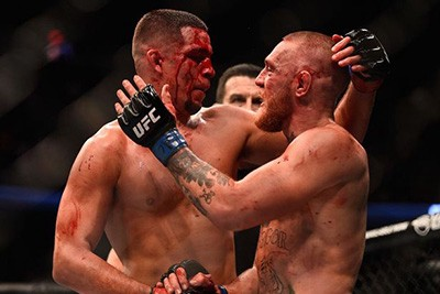 Nate Diaz and Conor McGregor embrace following their war UFC 202.