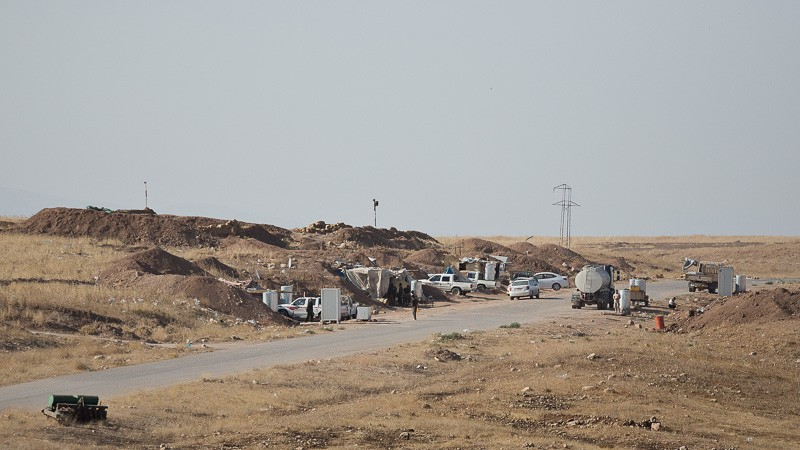 01/09/2015. Bashiqa, Iraq. A peshmerga position, set slightly back from the front line, on Bashiqa Mountain, Iraq. Bashiqa Mountain, towering over the town of the same name, is now a heavily fortified front line. Kurdish peshmerga, having withdrawn to the mountain after the August 2014 ISIS offensive, now watch over Islamic State held territory from their sandbagged high-ground positions. Regular exchanges of fire take place between the Kurds and the Islamic militants with the occupied Iraqi city of Mosul forming the backdrop. The town of Bashiqa, a formerly mixed town that had a population of Yazidi, Kurd, Arab and Shabak, now lies empty apart from insurgents. Along with several other urban sprawls the town forms one of the gateways to Iraq's second largest city that will need to be dealt with should the Kurds be called to advance on Mosul.