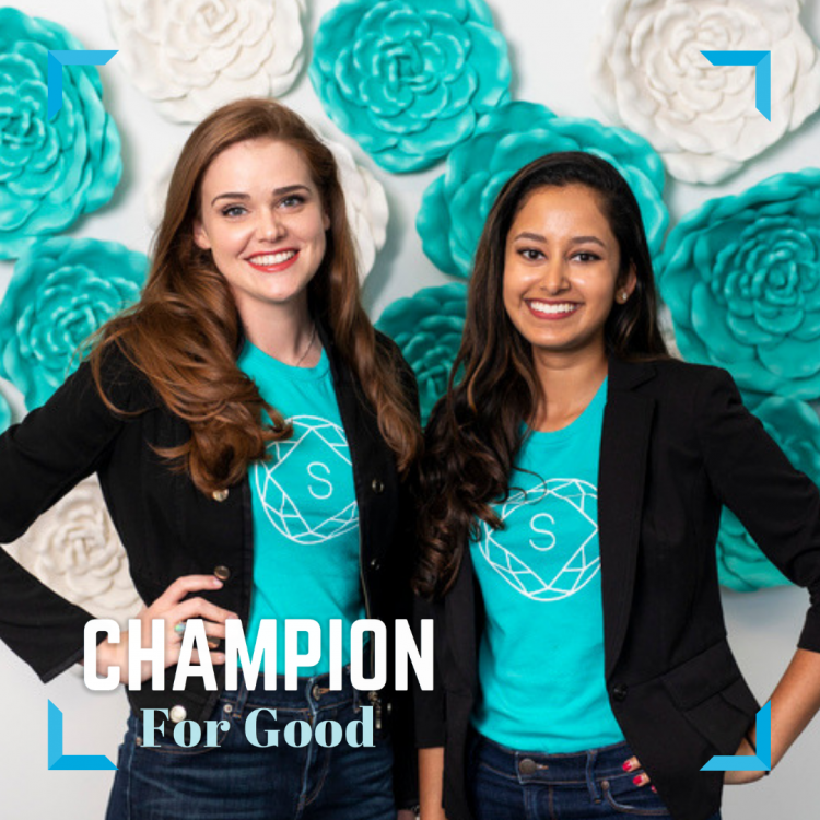 Statusphere partners stand in black jackets and teal shirts against a teal and white flowered background.