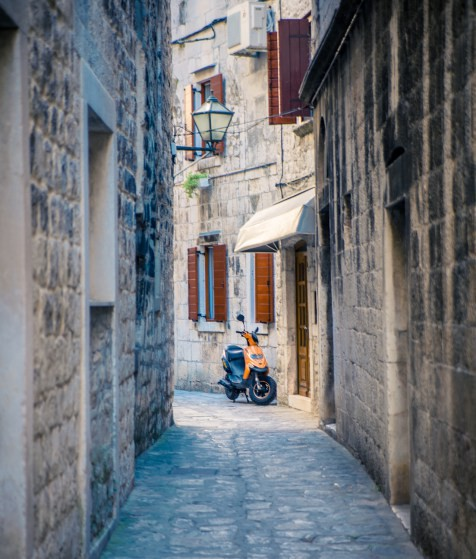 Lone scooter, alley, Trogir