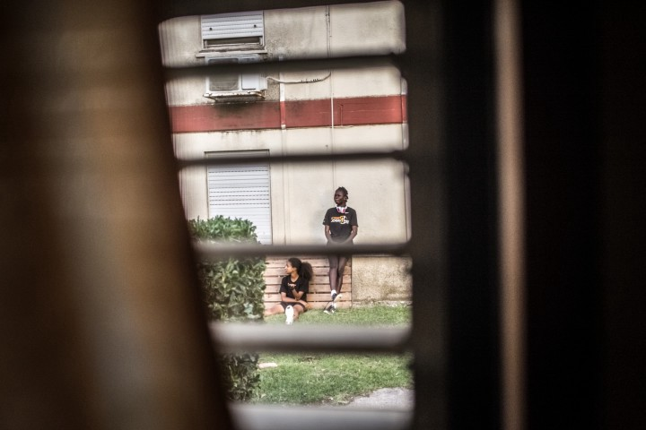 """Eritrean and South Sudanese athletes and asylum seekers Rahel (left) and Esteer (right) chill out in between practice runs in a training camp in northern Israel organized for their """"Alley Athletics"""" team."""