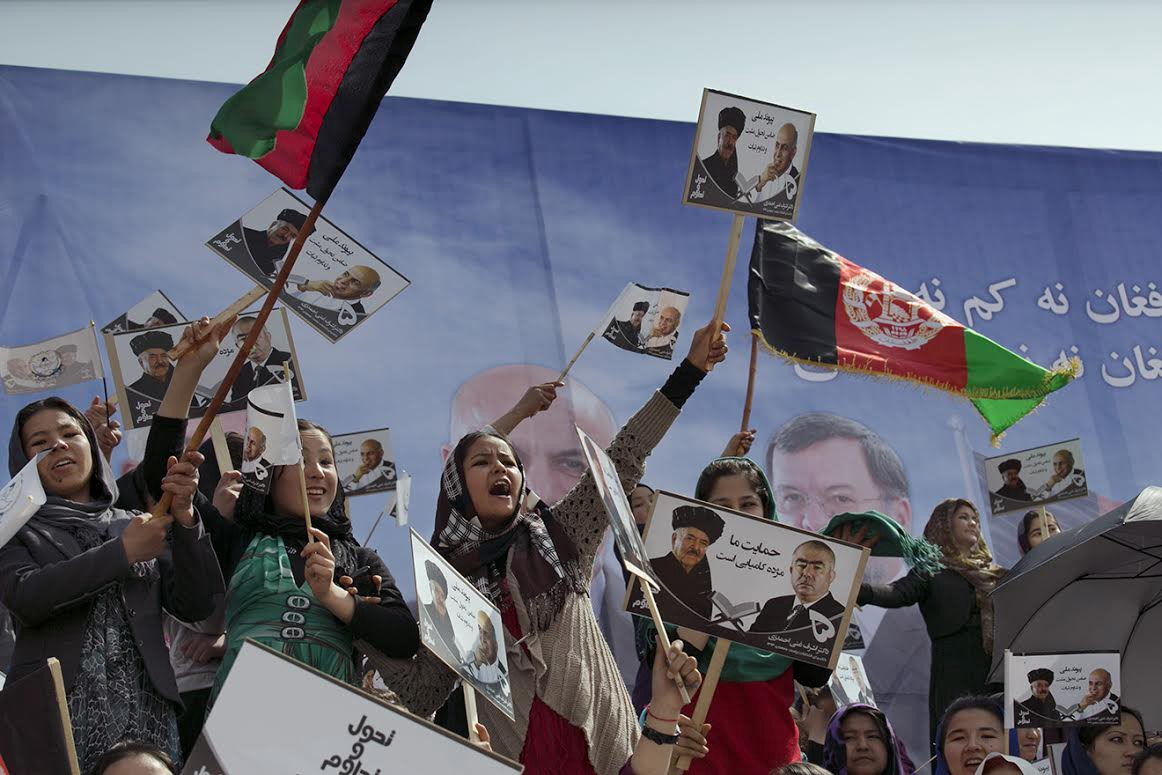 Young women cheer as they attend a rally for the Afghan presidential candidate Ashraf Ghani. (Kabul, April 1, 2014)