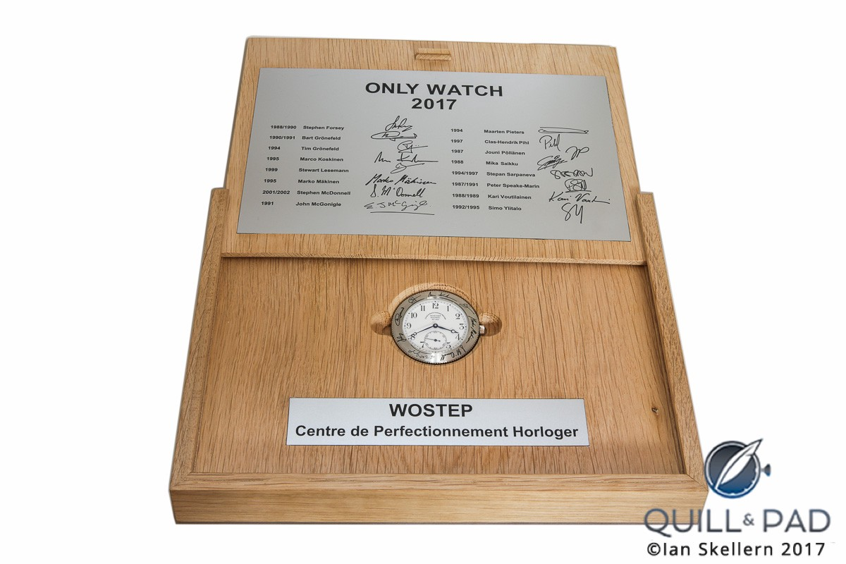 Sliding the presentation case cover open to view the WOSTEP School Watch for Only Watch 2017