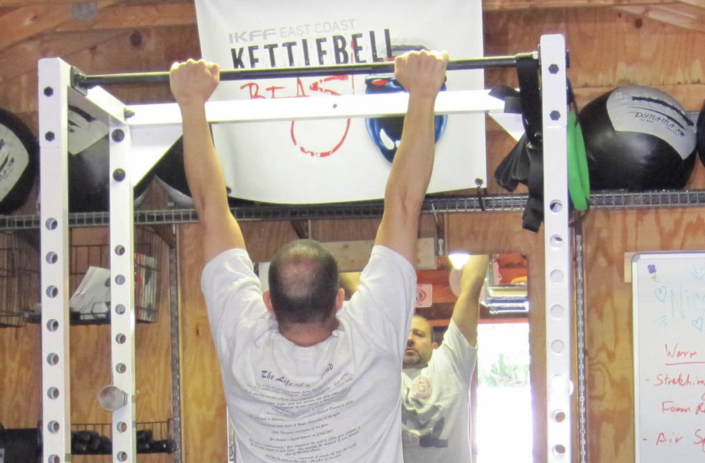 man in starting pull-up position with shoulders out of sockets