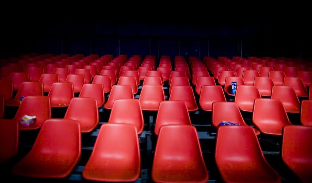 Room Full Of Empty Red Seats No Audience To Write For