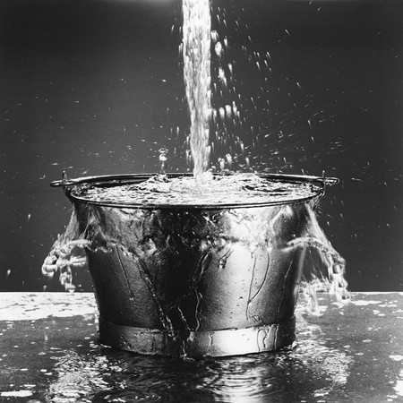 Water Pouring into a Bucket